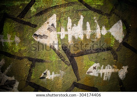Fish paintings on the rock. - stock photo