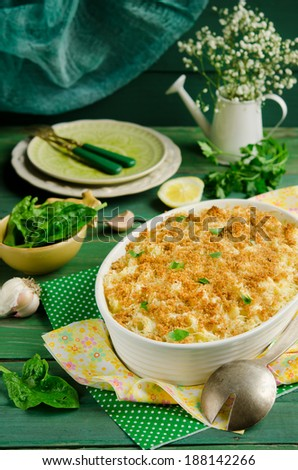 Fish pie baked with dorado, topped with mashed potato, breadcrumbs and cheese - stock photo