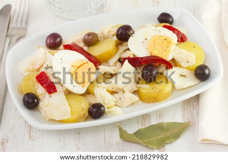 fish salad with olives - stock photo