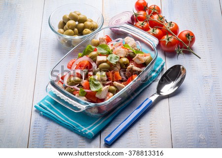 fish salad with swordfish tomatoes green olives and onion - stock photo