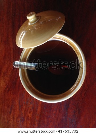 fish sauce,Garnish for noodles In ceramic cup on a brown wooden table. Flavoring  - stock photo