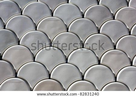 Fish scales background pattern in ceramic - stock photo