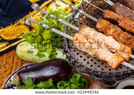 fish shashlik and kebab on table - stock photo