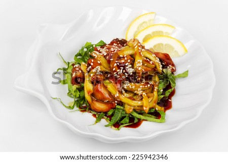 Fish smoked eel with unagi sauce and sesame seeds on lettuce leaves.  - stock photo