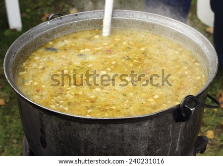 fish soup cooked in the traditional way - stock photo
