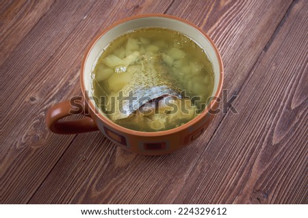 fish soup with codfish  - stock photo
