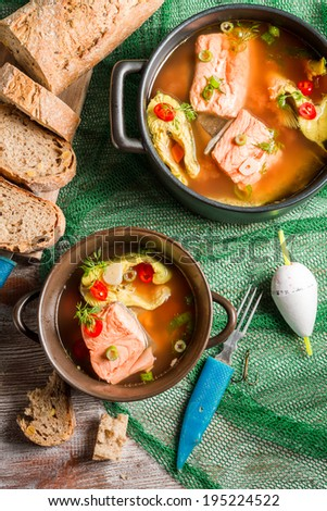 Fish soup with dill and chilli pepper - stock photo