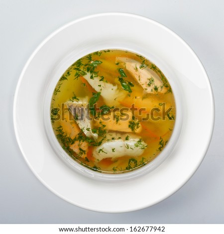 Fish soup with potato and carrots top view - stock photo