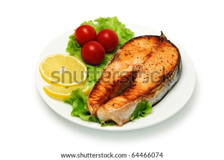 fish steak with vegetables on white background