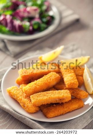 Fish Sticks with Salad - stock photo