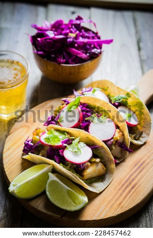 Fish tacos on wooden background - stock photo