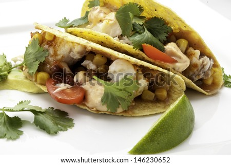Fish Tacos using corn tortillas.