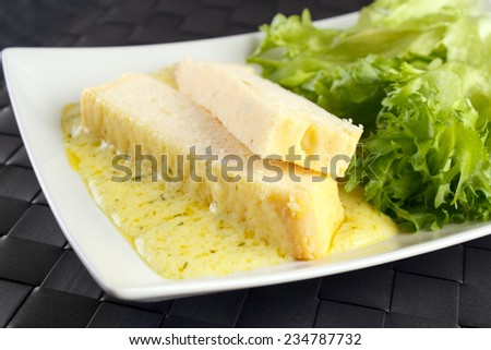 Fish terrine made from pike perch with sausage and lettuce - stock photo