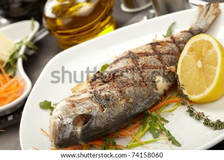 fish with lemon - stock photo