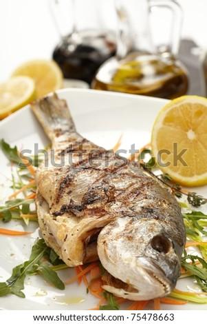 fish with lemon - stock photo