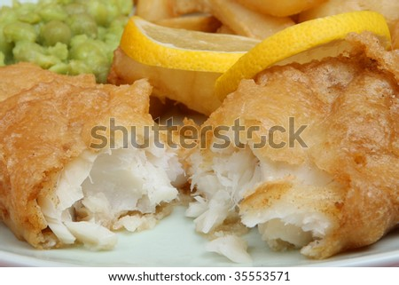 Fish with mushy peas and chips - stock photo