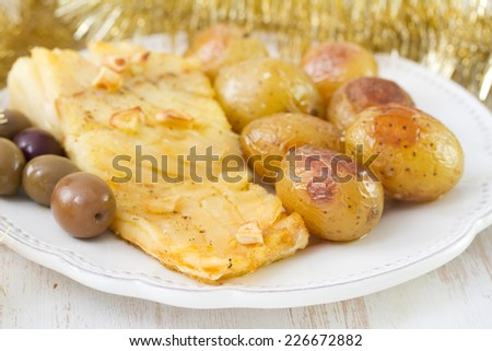 fish with potato and olives - stock photo