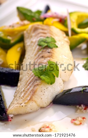 fish with tropical fruits - stock photo