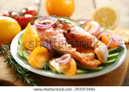 Fish with vegetables on plate