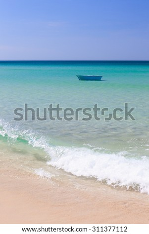 Fisher boat and clear turquoise water - stock photo