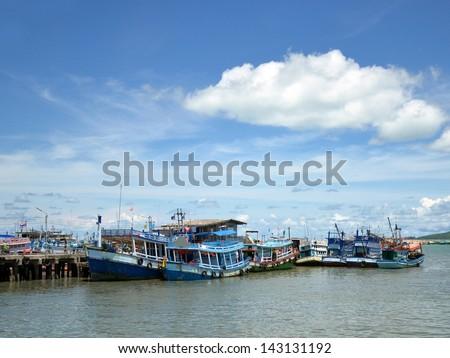 fisher boat pier at ra-yong, thailand - stock photo