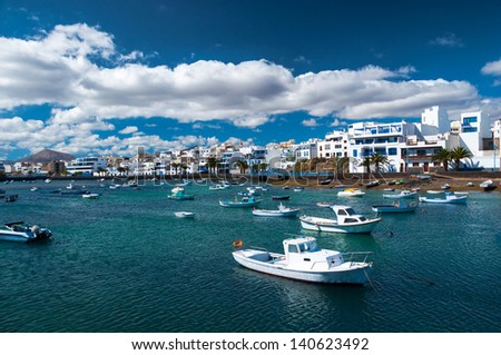 Fisher boats at the laguna Charco de San Gines, city of Arrecife, Lanzarote, Canary Islands - stock photo