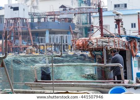 Fisher fishing nets and fishery - stock photo