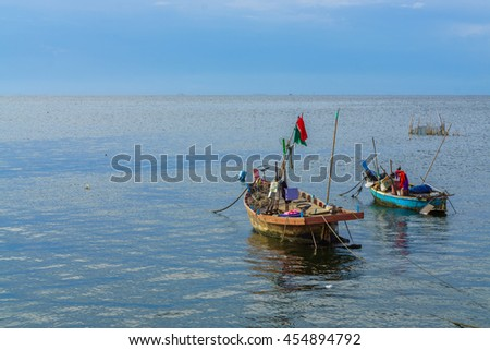 Fisher man boat on the sea.