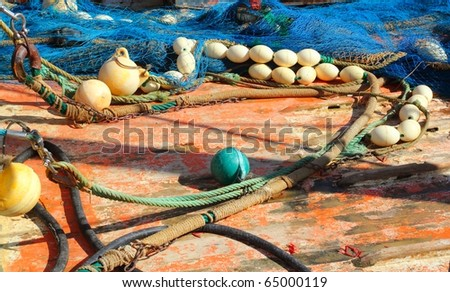 Fisherboat deck with net and tackle professional fisher boat - stock photo