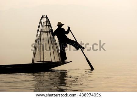 Fisherman are fishing at Inle lake in the mist. Inle lake, Myanmar. - stock photo