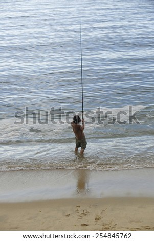 fisherman at the sea, in the north of spain - stock photo
