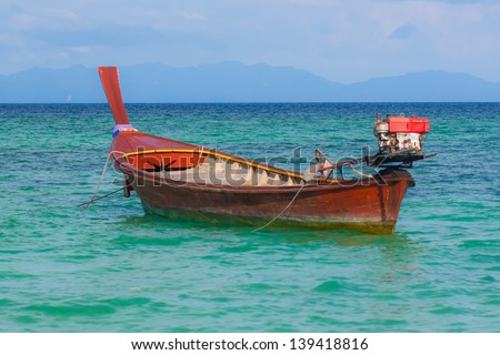 fisherman boat float in blue sea and clear sky.Lipe island.