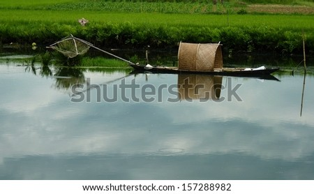 Fisherman boat on a river in Hoi An, Vietnam - stock photo