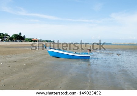 Fisherman boat on sea beach - stock photo
