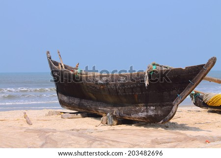 fisherman boat on the beach - stock photo