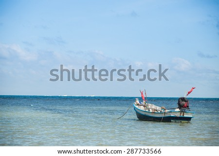 Fisherman boat with blue sky in koh phangan, Surat Thani, Thailand.