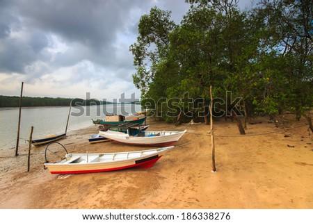 Fisherman boats park on the beach. - stock photo