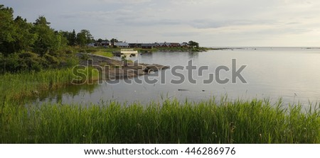 Fisherman cabins on the Swedish east coast in sunset - stock photo