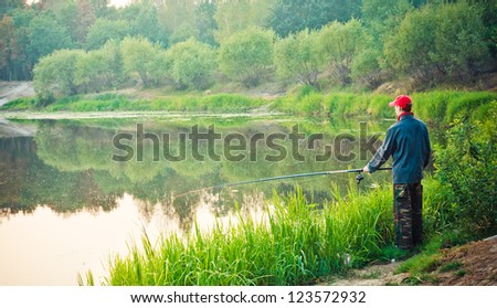 Fisherman Catches Of Salmon On The River Mouth. - stock photo