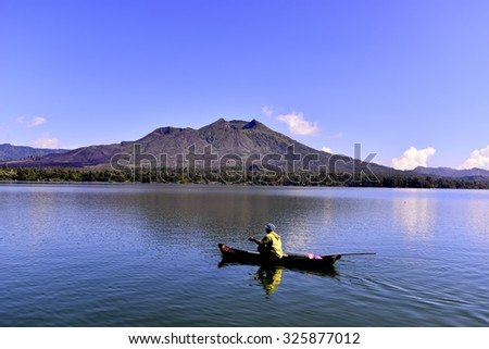 fisherman goes fishing in the blue morning - stock photo