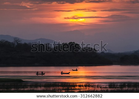 Fisherman in Arugam bay lagoon sunset, Sri Lanka - stock photo