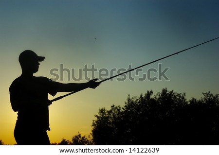 fisherman on sundown - stock photo
