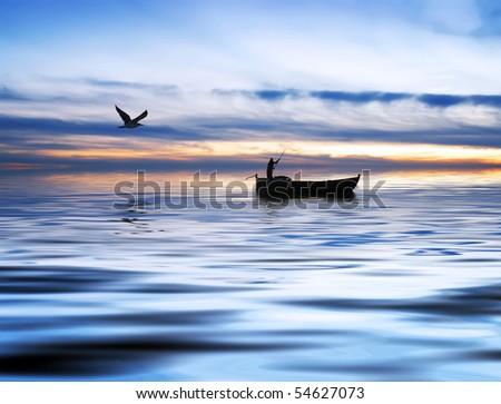 fisherman on the lake - stock photo