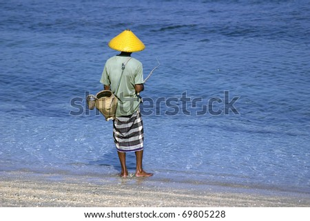 Fisherman on the shore of the beach in Lombok, Indonesia