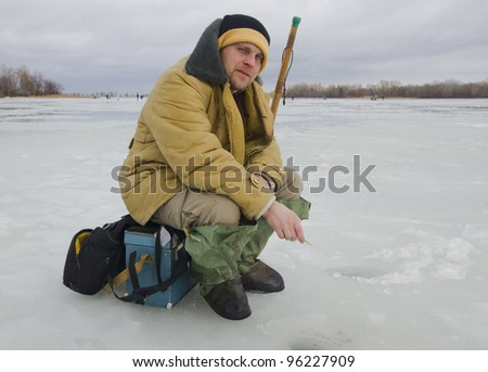 Fisherman on winter fishing