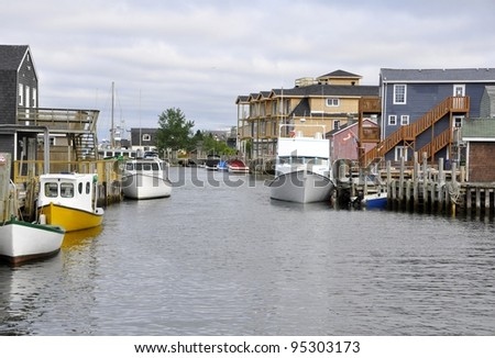 Fisherman's Cove  a 200 year old active fishing village on the shore  of the Atlantic Ocean in Eastern Passage, near Halifax Nova Scotia - stock photo
