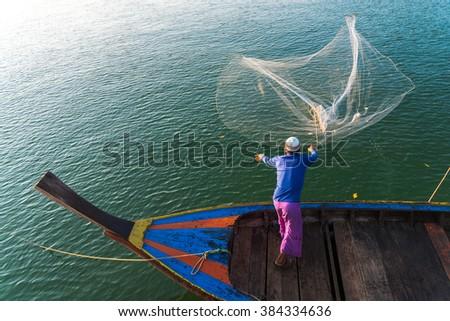 Fisherman throwing Fishing Nets, Thailand - stock photo