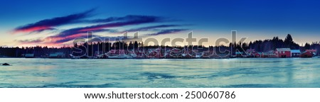 Fisherman village in Sweden at winter after sunset, panorama - stock photo