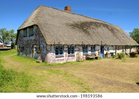 Fishermans Cottage on a Warft on the Hallig Langeness in the wadden Sea in the north of Germany. Langeness is a municipality in the district of Nordfriesland, Germany - stock photo