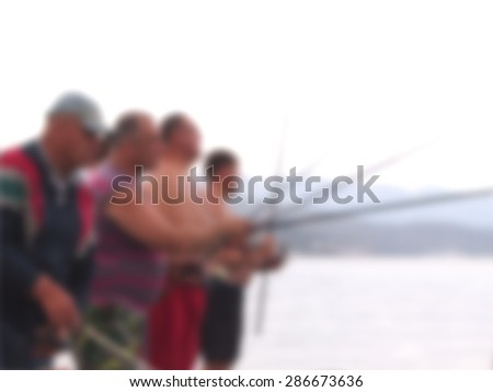 Fishermen, abstract blurred image out of focus